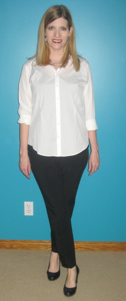 As classic as classic gets with a white top $3.50, black pants $5 and black pumps $14.