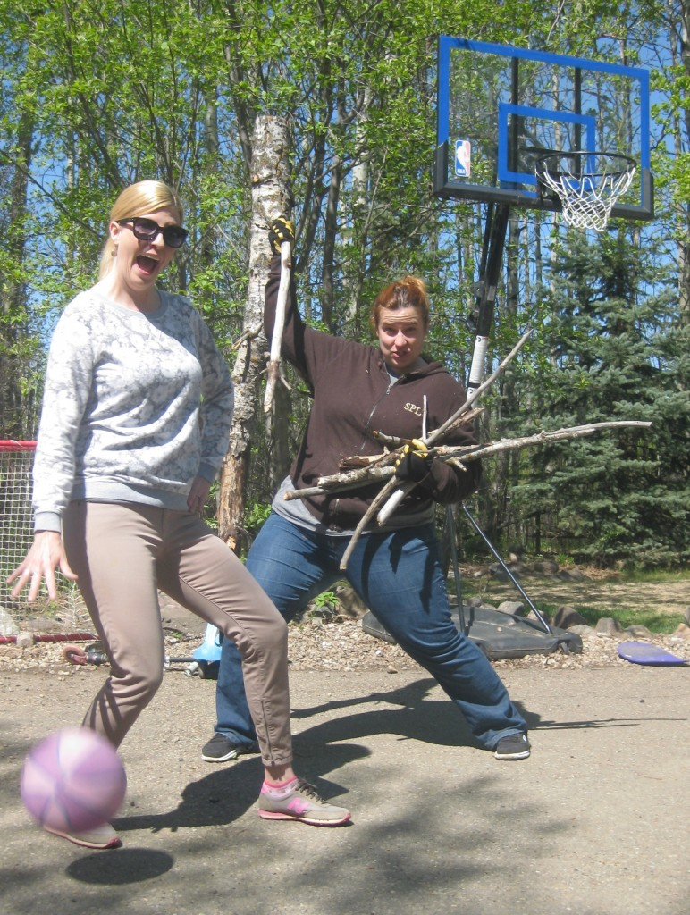 Me and my roomie/cuz - while I was busy taking sporty-styled shots, she was really working out hauling branches.