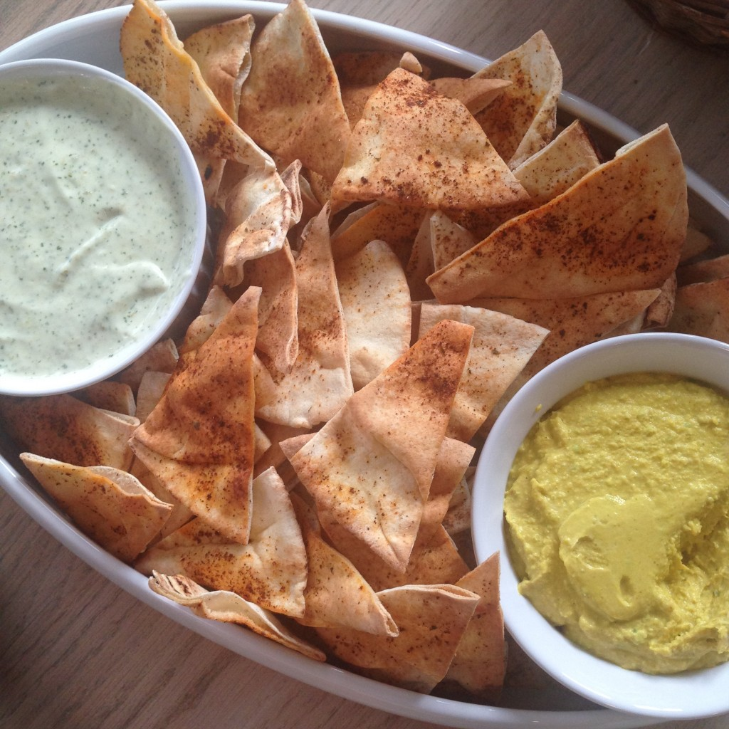 "Texas ""crack"" jalapeno dip and curry humus with homemade pita chips brought by Christina."