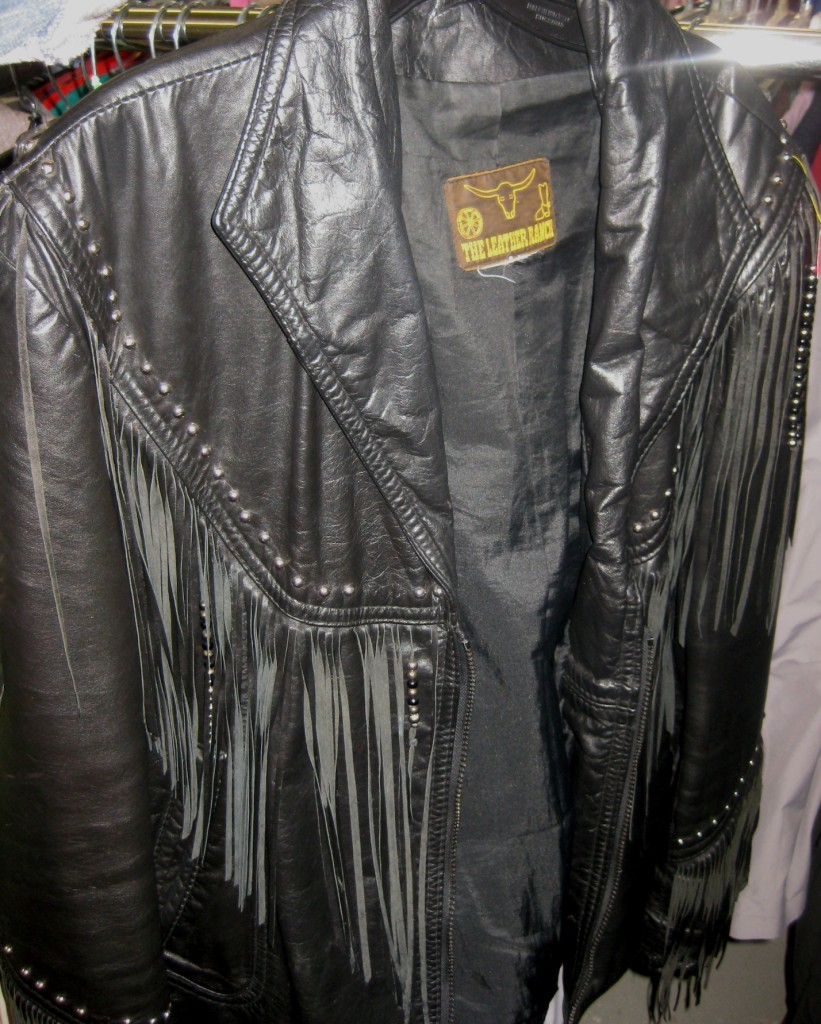 Vintage fringe leather jacket.  Can't recall the exact price but with the sale, I believe it was $20 or under.
