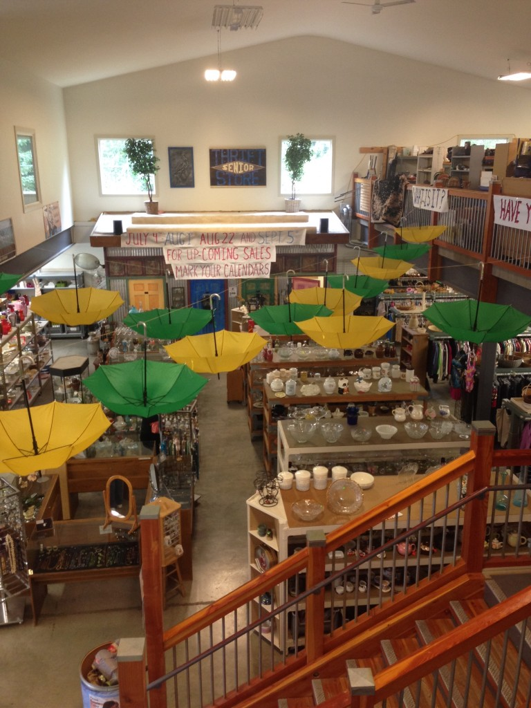 "This is the view from the second floor of a ""little"" community thrift shop in"