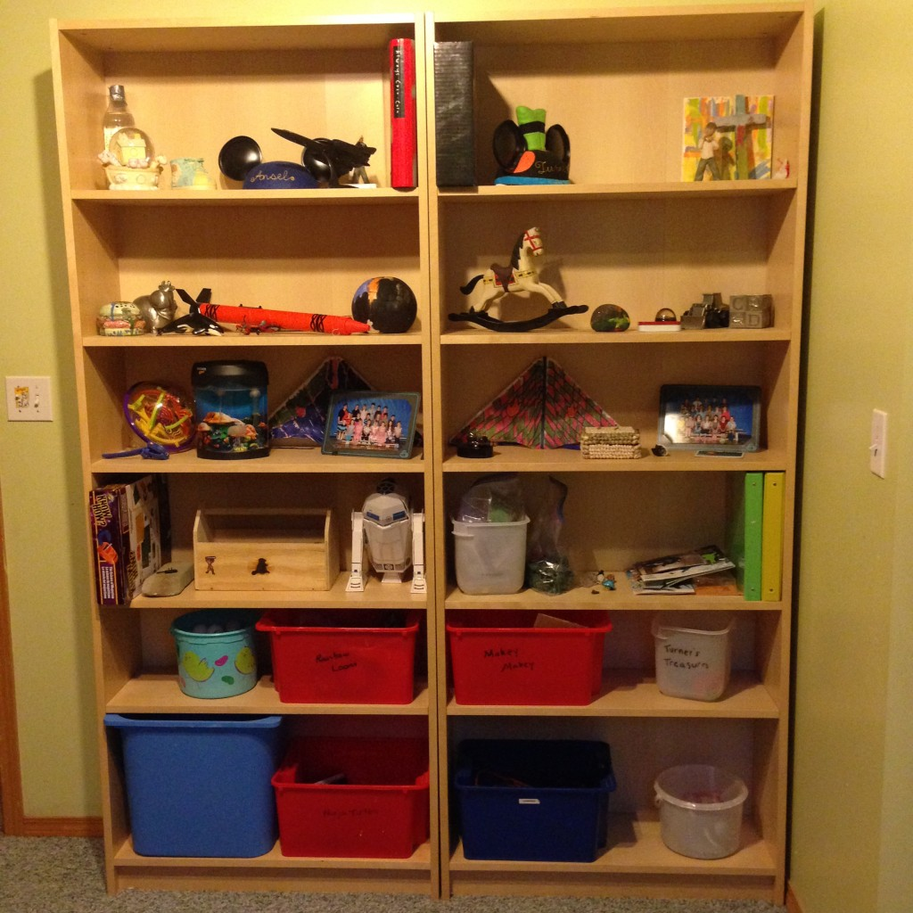 And despite our best efforts, these toy shelves still don't have much empty space BUT the boys assure me everything they kept sparks joy and there is LESS stuff, all with its own place.