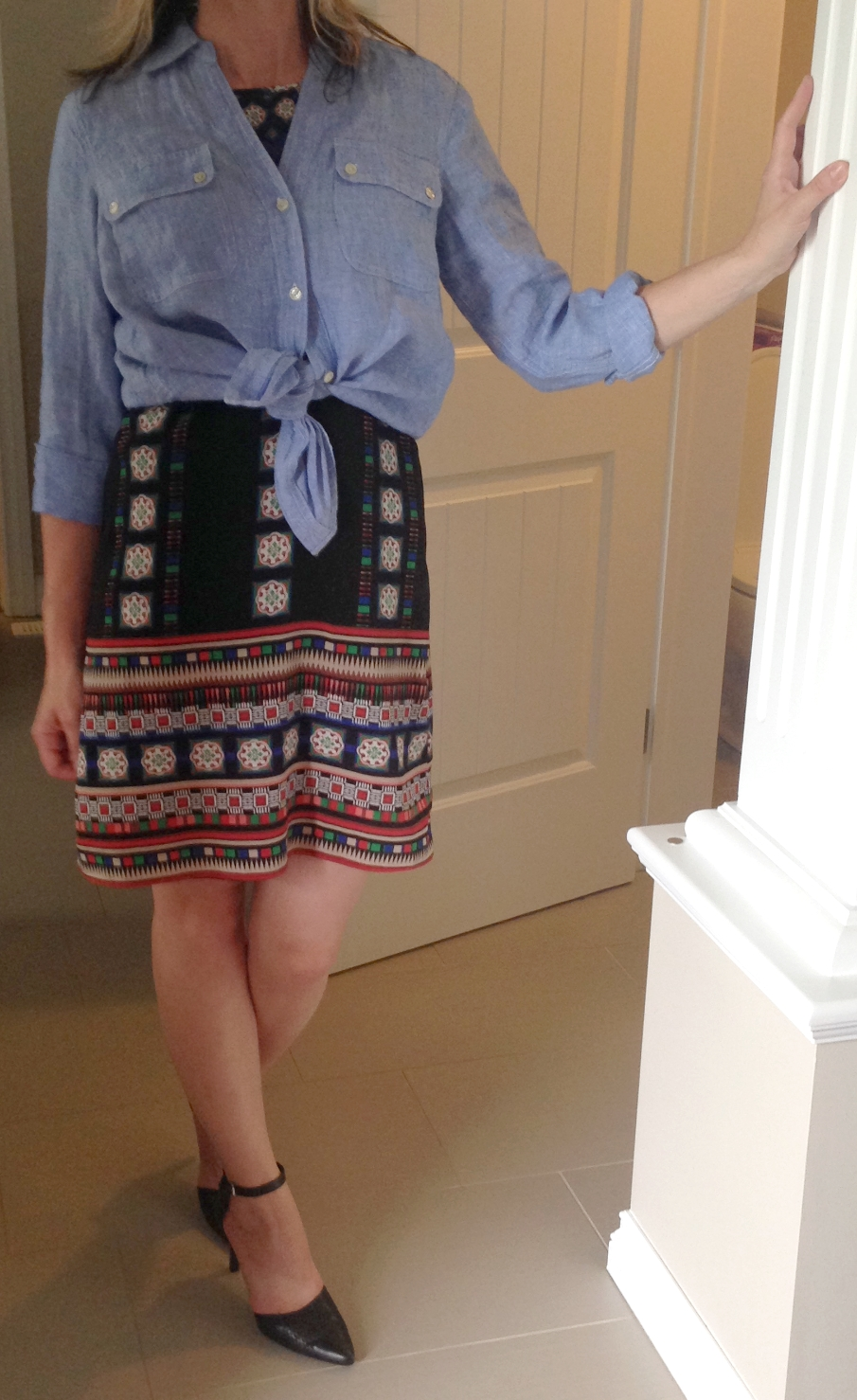 """Another stylish way to wear a chambray is knotted over a dress.  It acts as a finishing layer and adds a casual touch that gives more mileage to """"fancy"""" dresses."""