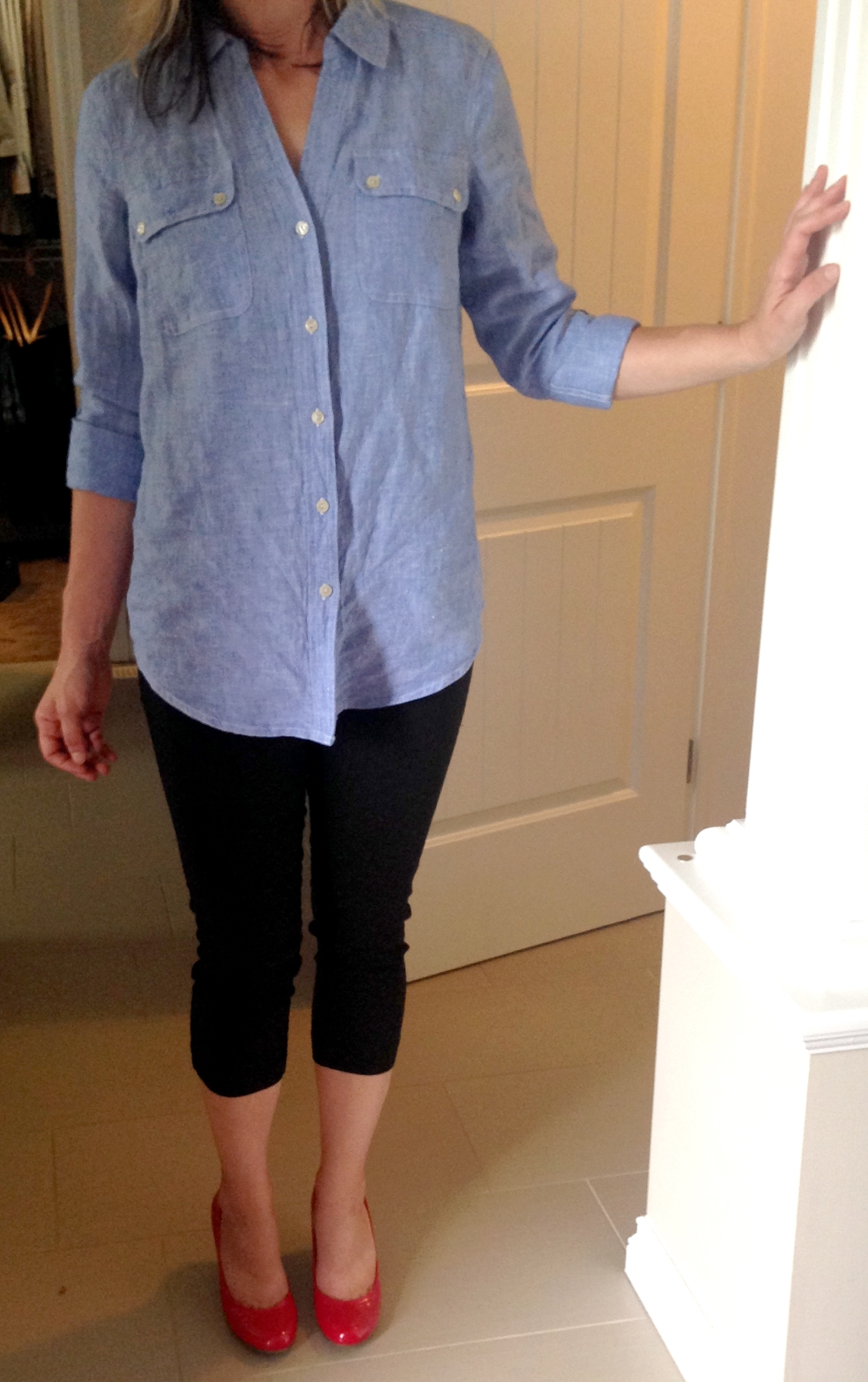 One of the easiest and chicest ways to style a chambray is simple - loose over skinny black denim or leggings with a pop of colour.  Thank God for those red shoes - they're fab!