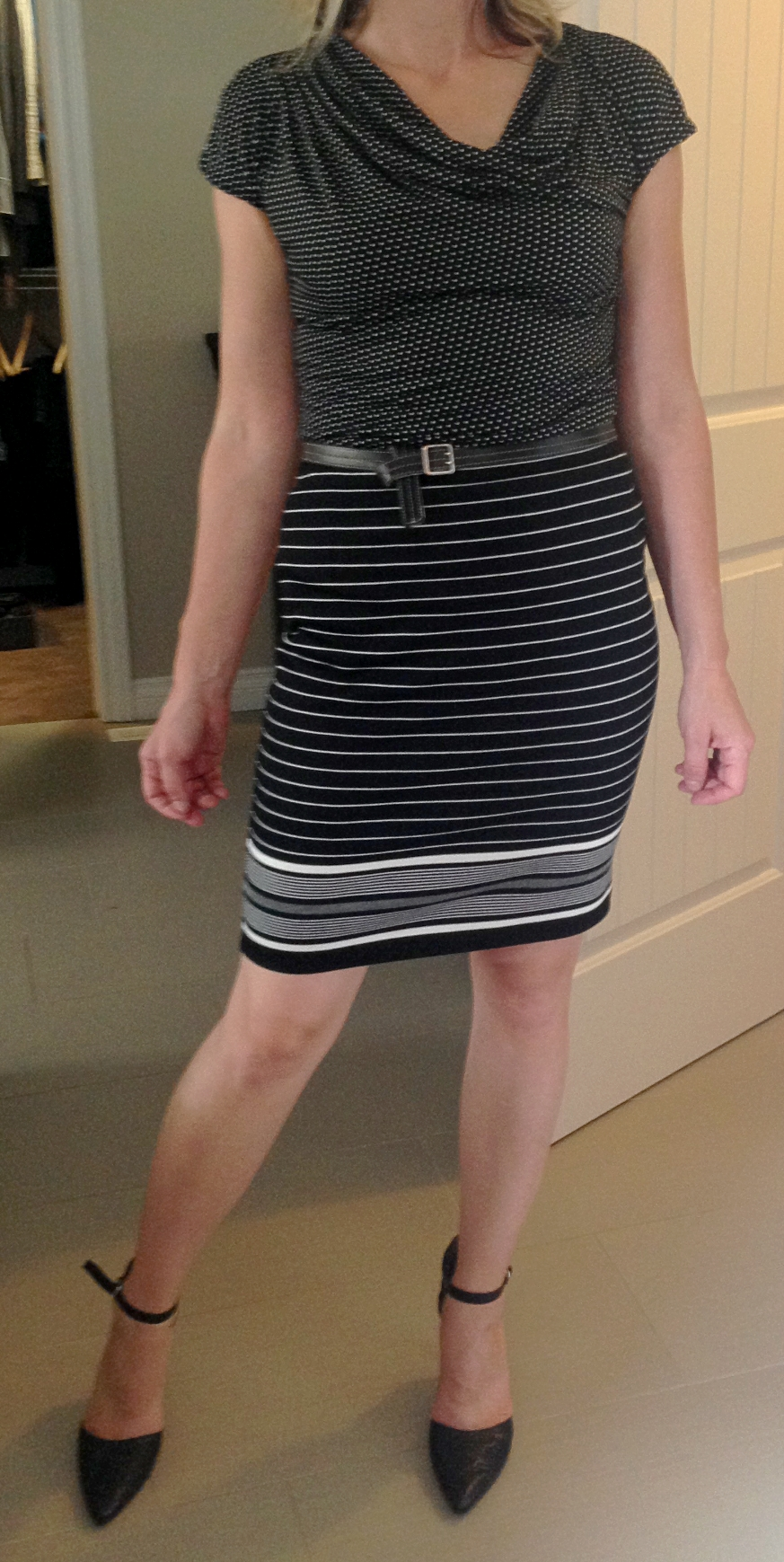 She did have a striped skirt that she typically wears with a black top.  Classic patterns pair well - stripes and florals, stripes and polka dots... Again, you can use a belt as a transition between patterns.