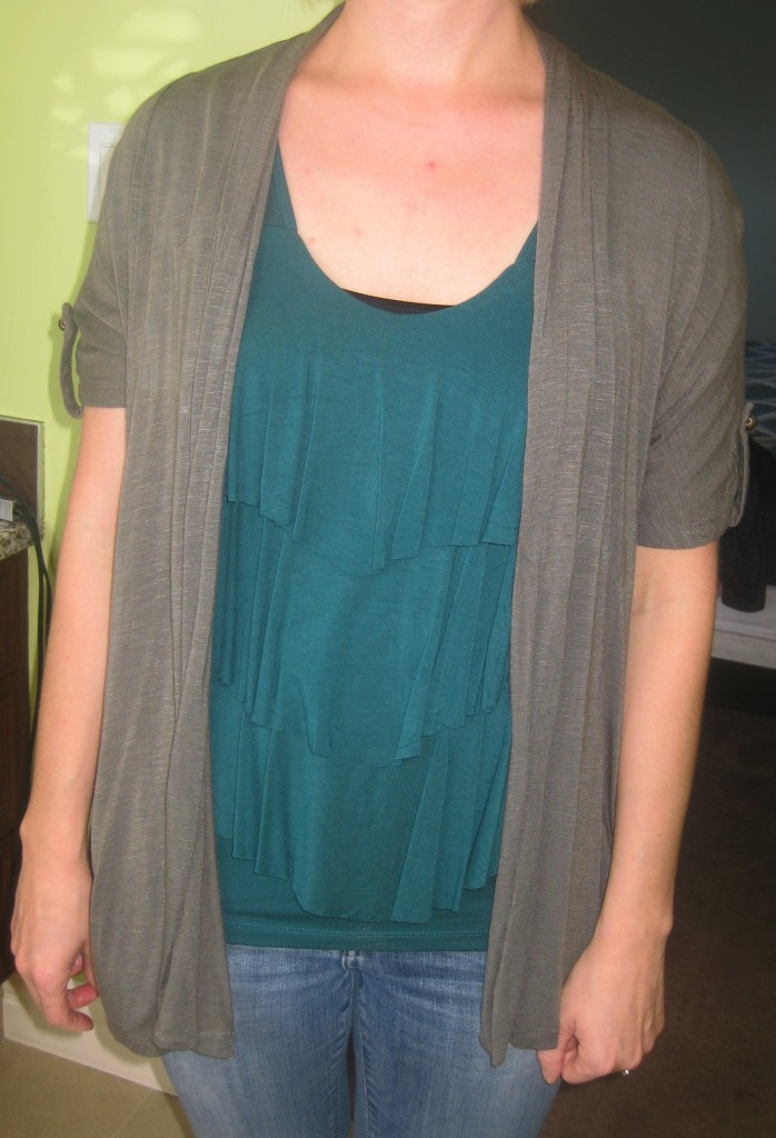 Olive/taupe is a neutral which means you can mix it with ANYTHING including a teal top or anything in the green family.