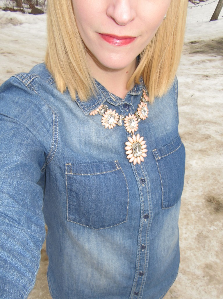 Nothing says preppy quite like a button-up shirt and statement necklace.