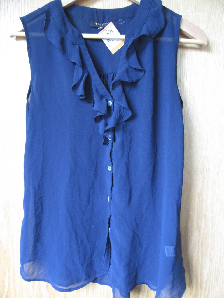 I'm not normally a ruffle person but couldn't resist this pretty navy sleeveless blouse for $3.50.
