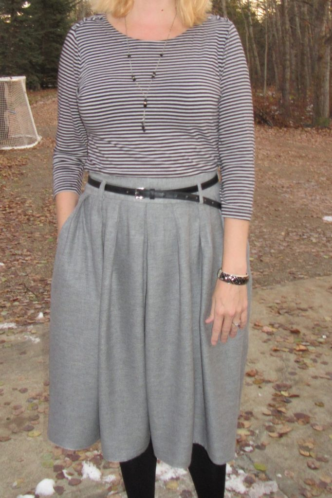 The stripes up top help to balance out the fullness of the skirt.