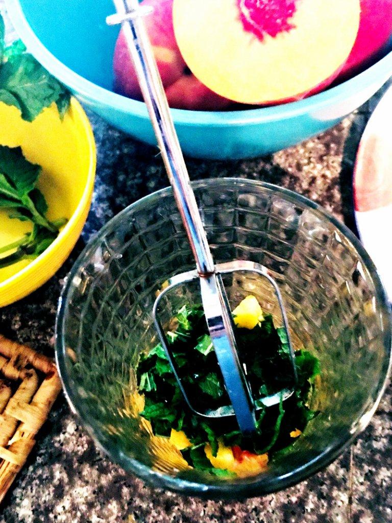 Smashing peaches, mint, lemon juice and honey with an improvised muddler!
