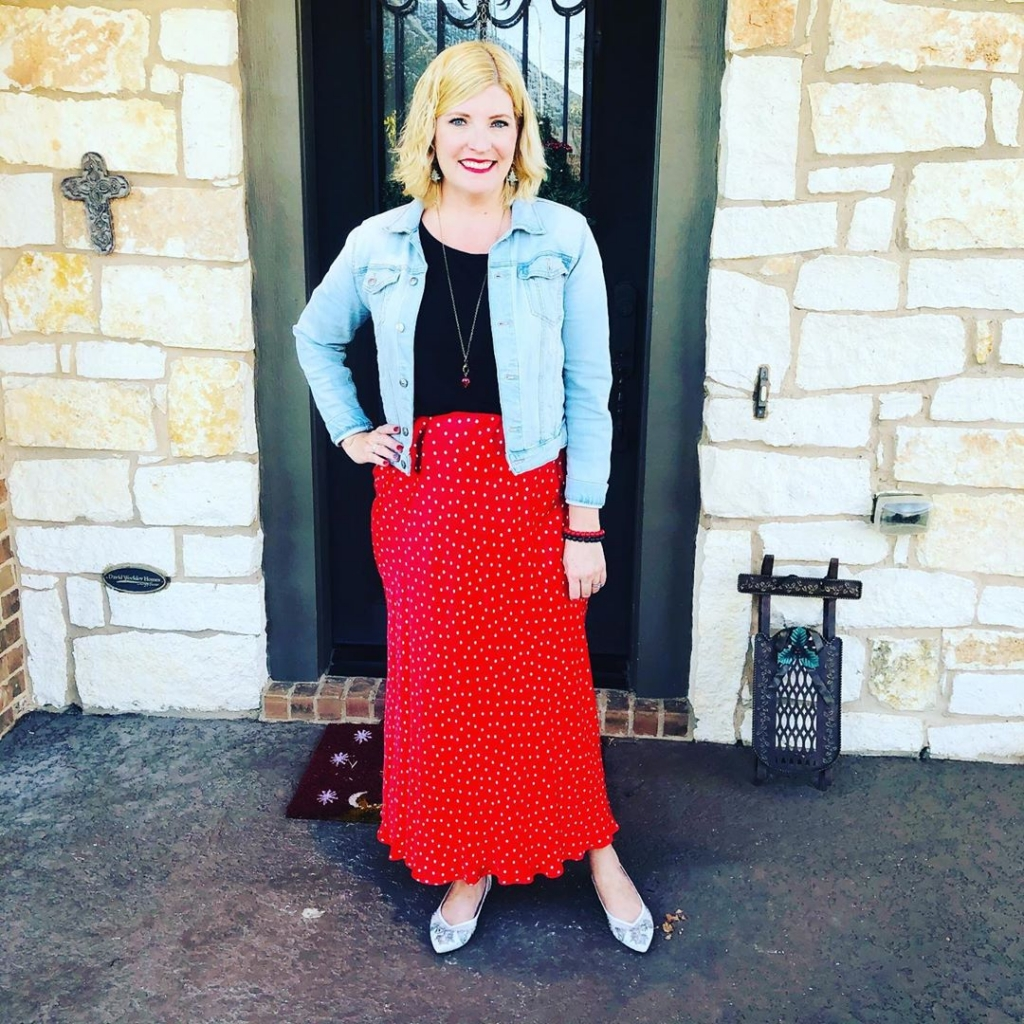 "Red polka dot maxi skirt with a black top and denim jacket featured in ""Are prints still in style in 2020?"""