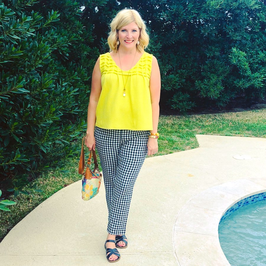 The Spirited Thrifter in gingham pants and a bright yellow top.