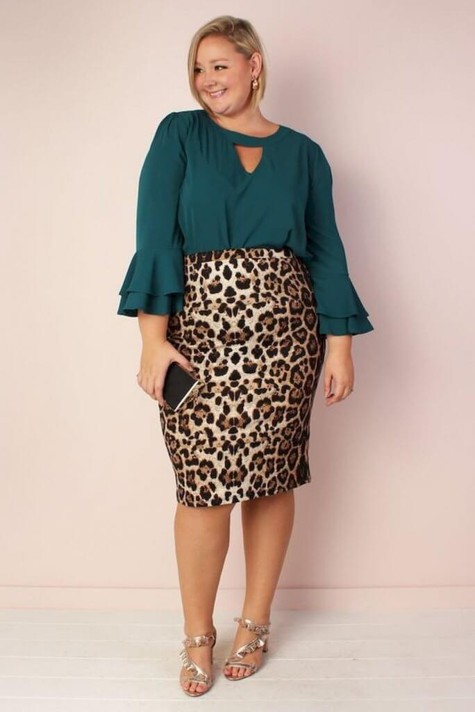 Allison Kimmey wearing a leopard print skirt with green blouse.